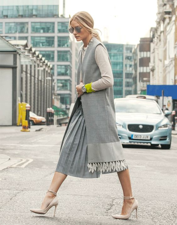 Olivia in Tibi pleated culottes with a Nom De Mode vest layered over a Chinti and Parker sweater, a Capwell + Co necklace, Dior aviator sunglasses and Gianvito Rossi heels.: