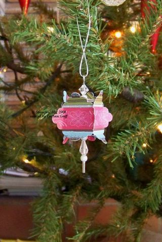 Scallop square ornament.  This could be made out of old christmas cards (maybe).