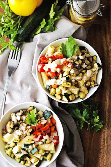 Pasta with vegetables and roasted garlic tahini sauce