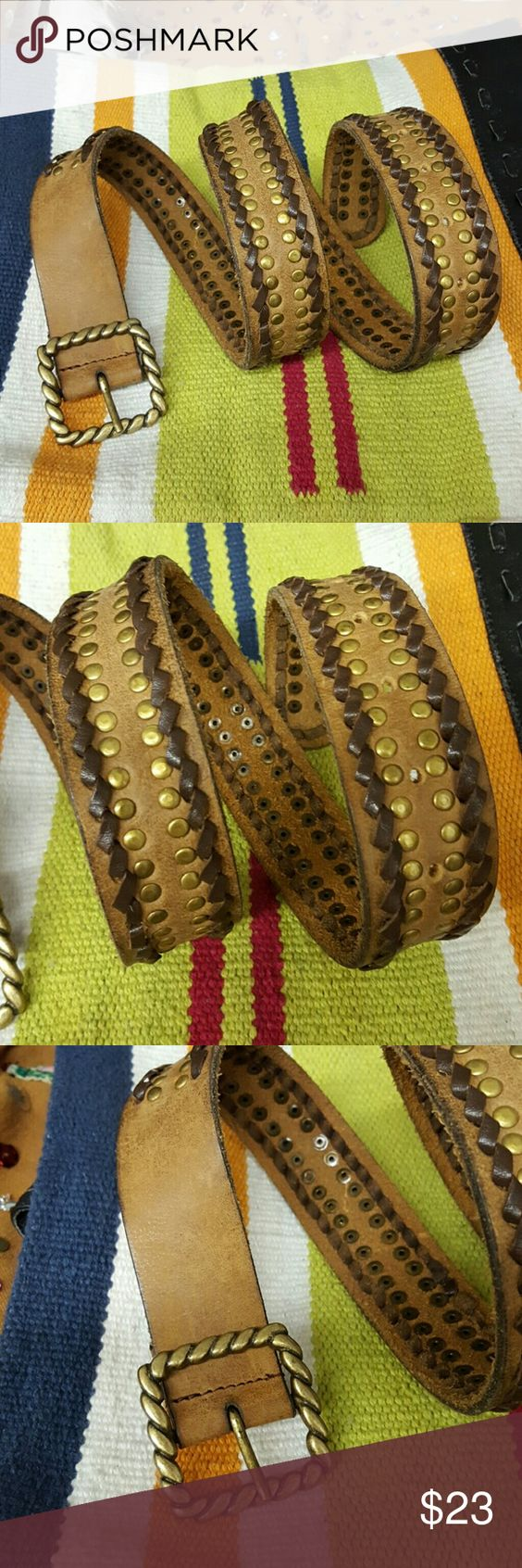 BOHO style leather belt. Laced and studded BOHO style leather belt. Laced and studded. Brushed gold buckle and studs. Accessories Belts