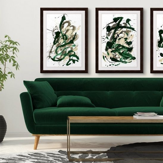 Glamorous Space With Abstract Framed Prints Hunter Green Black And Gold Might Seem Like A S Green Sofa Living Room Green Living Room Decor Green Sofa Living