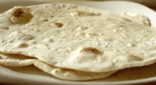The 40 Calorie Flour Tortilla  1/8 Teaspoon Salt  .5 oz Water  1/4 Cup Flour  1/8 Teaspoon Baking Powder  Servings: Creates 2 Tortillas (1 Tortilla = 1 Serving)    Nutritional Facts:    Calories Per Serving: 41.25 cal  Fat (g) per Serving: 0.00 g  Carbs (g) per Serving: 8.63 g  Protein (g) per Serving: 1.13 g  Sodium: 32.50 mg  Financial Facts:    Cost Per Serving is $0.01.  Combine all ingredients, split into two, roll on flour, cook with no oil. Enjoy!