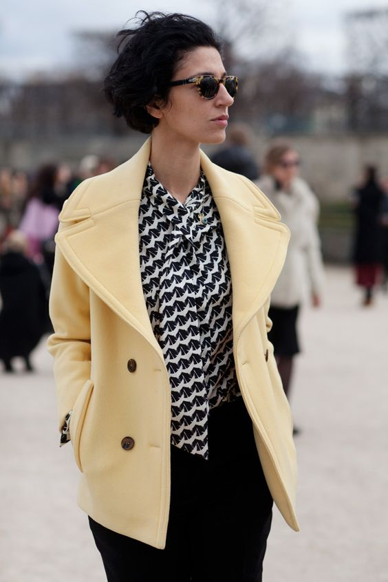 liking the yellow coat with black and white top