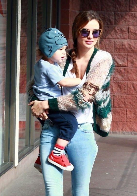 Miranda Kerr Wearing Miu Miu MIU10NS NOIR Sunglasses in New York http://pict.com/p/0N
