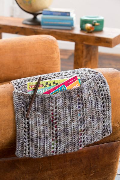 Crochet Armrest Cozy - Use this convenient crochet caddy to hold all your necessities, from the TV remote to your latest crochet pattern. Simply place the flap under a cushion or over the arm of a chair and it's ready to use. Designed by Cathy Black. From I Like Crochet's April 2014 issue