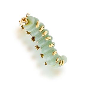 A jadeite jade brooch designed as a caterpillar, with circular-cut diamond eyes; mounted in fourteen karat gold; length: 2in.