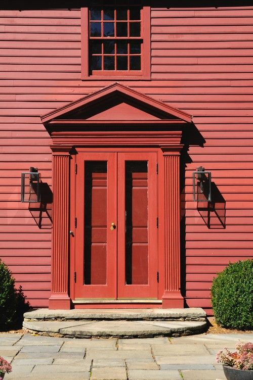 The History And Charm Of A Red Front Door Garage Door Design Carriage House Doors Colonial Style Homes
