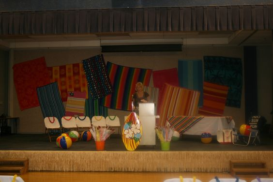 use of beach towels for the backdrop of the stage for 6th grade graduation