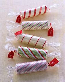 Toilet paper roll, use glue dots to wrap with wrapping paper, put a small gift inside, wrap with clear wrap / Great Christmas tip!