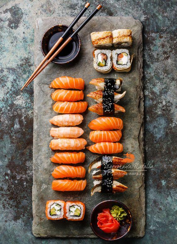 суши - Sushi Set sashimi and sushi rolls served on stone slate