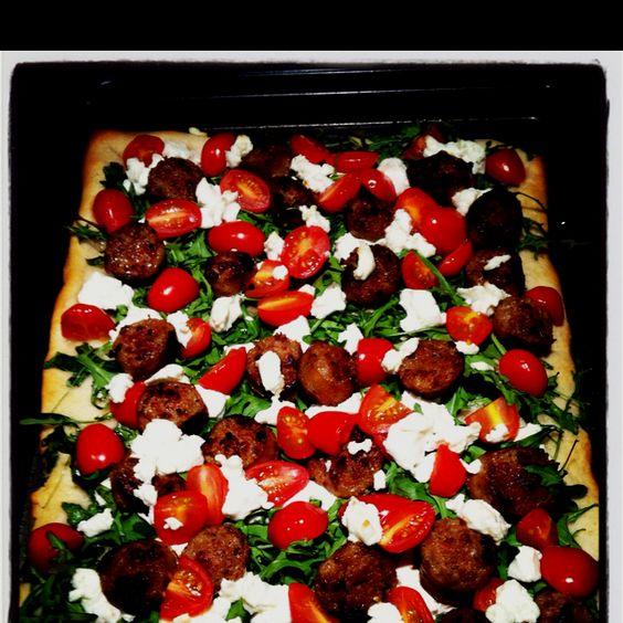 Sausage, arugula, tomato and goat cheese pizza | Food & Drink ...