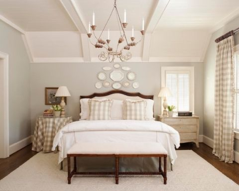 white plates above bed