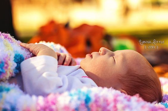 Newborn outside on blanket