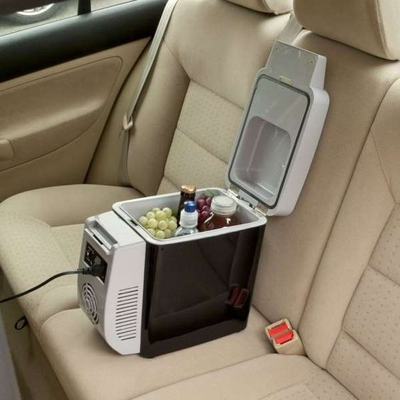 A personal fridge for your car. Fits in the armrest spot and plugs in to your charger! #cargifts