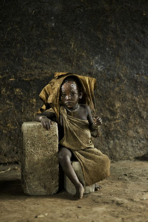 stevemccurrystudios:  This child is a member of the Suri tribe.NEW BLOG IS LIVEhttp://stevemccurry.wordpress.com/2014/02/24/children-of-the-omo/ Exhibition at Kunsthalle Erfurt, Germany,OpensFebruary 21,2014 Beetles & Huxley Fine PhotographsLondon, UKOpens May 12, 2014Afghanistan