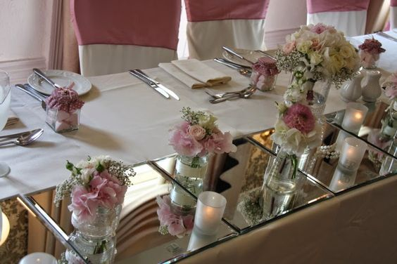 On the top table a series of mirrors provided a reflective surface for our small and elegant posies.