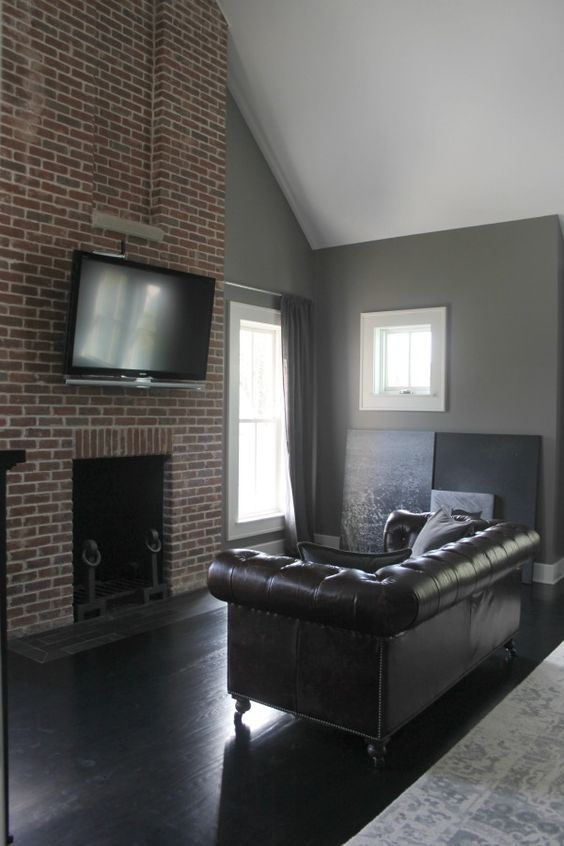 Floor to ceiling red brick fireplace in bedroom. Modern Industrial Farmhouse Bedroom Design {2nd Floor Tour}. #modernfarmhouse #bedroom #greywalls #luxuriousfarmhouse #benjaminmooreplatinum #benjaminmoorestoningtongray