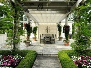 Outdoor seating underneath beautiful pergola