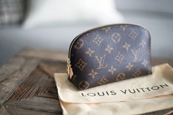 Little Louis Vuitton makeup bag.