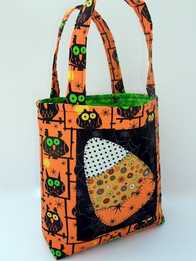 This hand made Halloween trick or treat bag is decorated with an appliqued candy corn - too cute!