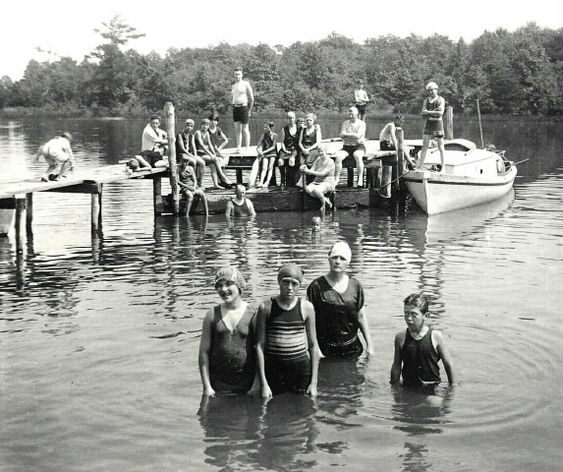 Swimmers in a river at Maple Hill Farms in Claiborne.