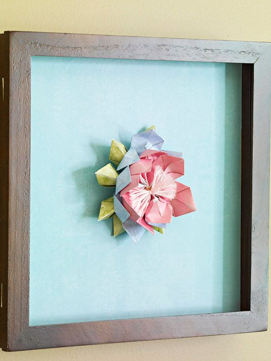 Origami lotus flower in shadow box