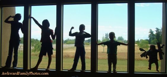 That awkward moment when you have to tape your baby to the window for the family picture.....