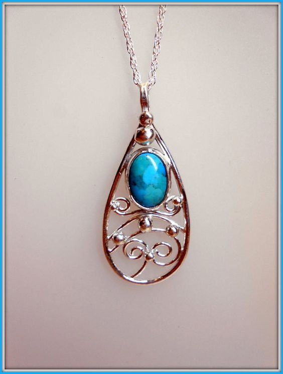 Handmade Pendant in Fine Silver with Turquoise cabochon.