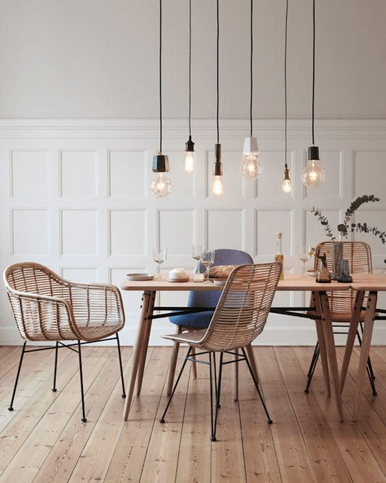 Bamboo / rattan furniture in the dining room of a light and airy Danish home with natural touches. Hubsch.: