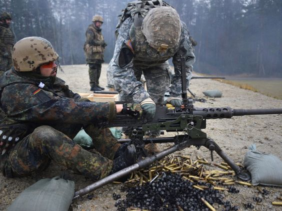 U.S. Soldiers, assigned to the Combined Arms Training Center, 7th Army Joint Multinational Training Command (JMTC), conducting a familiarization training with German soldiers on U.S. weapons at the JMTC's Grafenwoehr Training Area, Germany, Dec. 09, 2015.