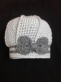 This cute crochet hat features post stitches for eye-catching texture and a cute crochet bow.