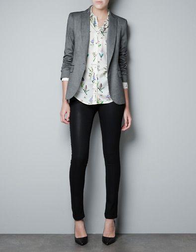 Grey blazer, floral button-up shirt, black trousers, black pumps -- work outfit