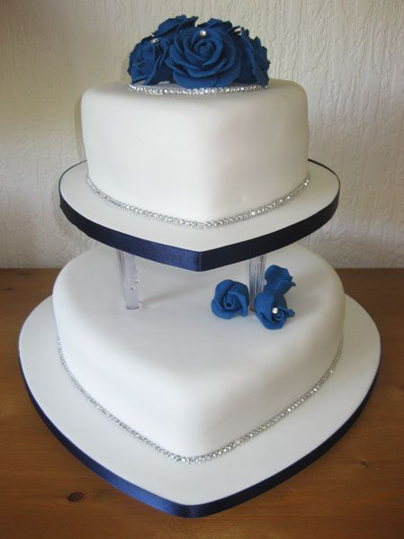 Blue rose, two-tiered, heart shaped wedding cake.