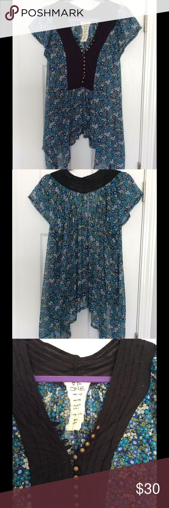 Free people top Pretty floral top from free people. Size medium/large but will fit XS-large. Drapes nicely.  Please keep in mind when submitting offers that poshmark takes 20%. This is also listed for less on my eBay account: photoflo10. Free People Tops Blouses