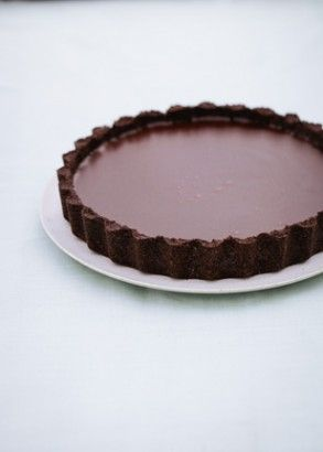 Salted Chocolate Tart: I have always avoided making chocolate tarts, not out of laziness (I love a bit of pastry-making, in the right mood), but because I have never really felt that the pastry served the chocolate, or was worth the effort here. This is my simple solution: make a base out of chocolate biscuits. And the filling is just as easy to make, too.