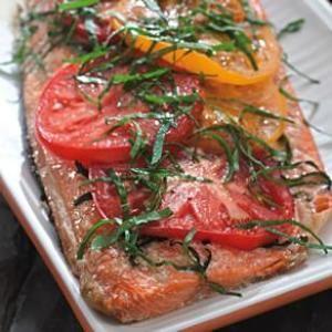 Grilled Salmon with Tomatoes & Basil  -  Fresh tomatoes add their sweet acidity to a rich salmon fillet for a simple and sophisticated summer dinner. From EatingWell, found at www.edamam.com.