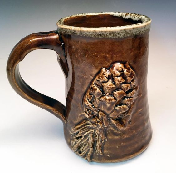 Rustic Stoneware Pine Cone Mug in Warm Amber Brown with drip glaze by MudPiePotteryShop on Etsy
