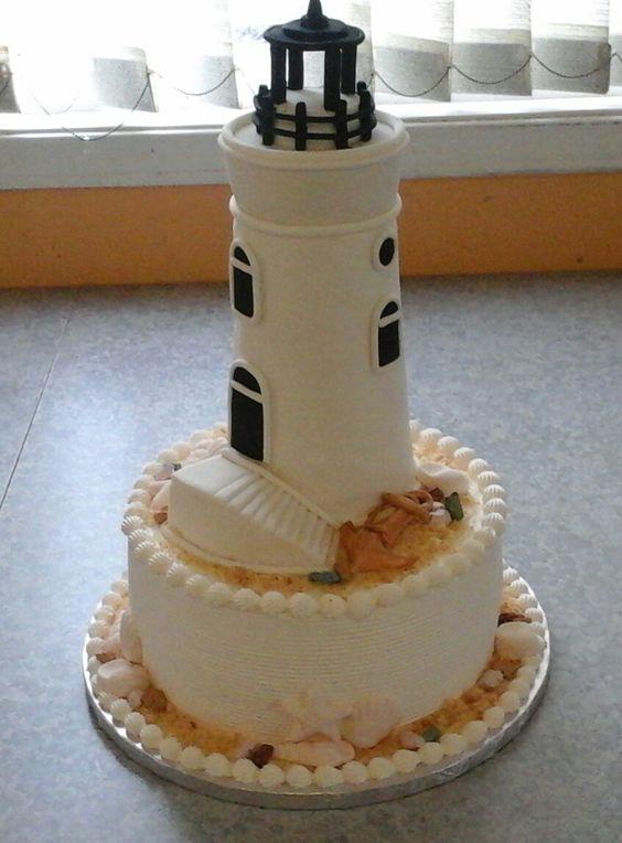 A beach lighthouse wedding theme cake