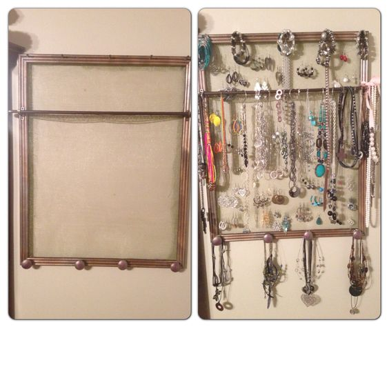 Jewelry organizer made out of old frame, curtain rod, some knobs, etc.