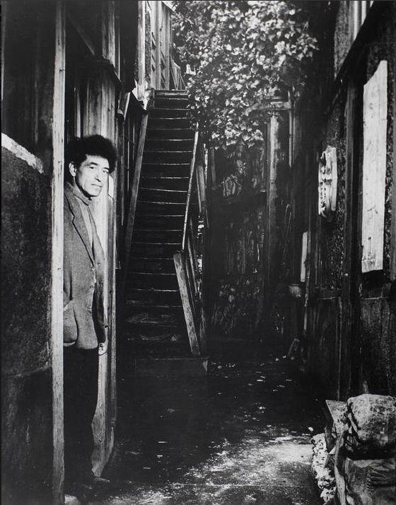 By Brassaï (1899-1984), 1/1948,  Giacometti at the door of his studio, rue H. Maindrou, 14e, Paris.