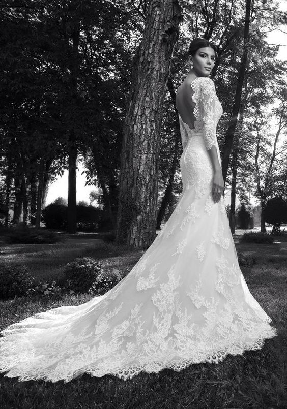There's something about an open back and lace sleeves on a wedding dress! Its absolutely beautiful. A dress that I hope to wear one day.