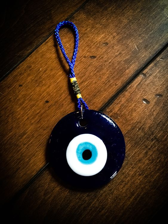 "Evil Eye Nazar Amulet // Evil Eye Amulets are alleged to protect you from looks charged with envy, fear, resentment or other negative thought. The evil eye is a curse believed to be cast by a malevolent glare, usually given to a person when they are unaware. Many cultures believe that receiving the evil eye will cause misfortune or injury. Talismans created to protect against the evil eye are also frequently called ""evil eyes"". The idea expressed by the term causes many different cultures to p"
