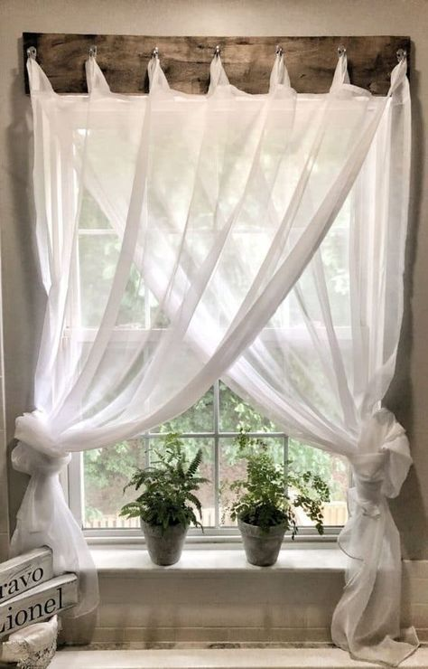 Struggling with window treatments? I needed a simple farmhouse window treatment for my bathroom. Check out how I came up with this inexpensive solution.