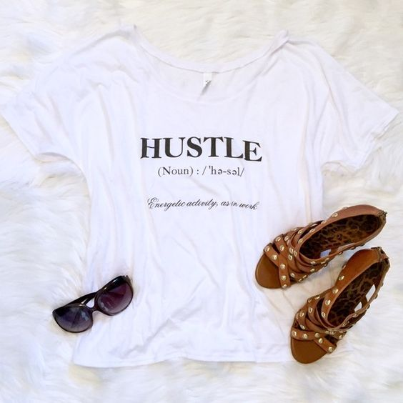 Soft 'HUSTLE' definition tee Slouchy soft relaxed tee with an open neckline. Curved hem and looks great as an off-the-shoulder look. Viscose blend. Fits true to size. Tops Tees - Short Sleeve