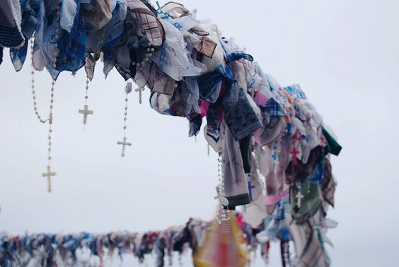 People leave their hopes and 'thank yous' in handkerchiefs and Rosaries, at Mount Calvary