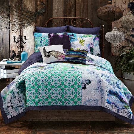 Outfit your guest room or master suite in eye-catching style with this cotton quilt, featuring an exotic patchwork motif.  Product: ...