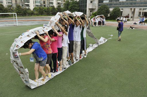 Human caterpillar wheel all you need is lots of newspaper tape and