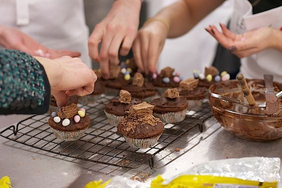 Decorating Easter egg truffle cakes at Leith's School of Food and Wine. All hands on deck!