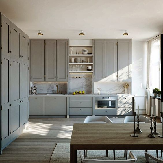 Gray kitchen with a marble backsplash.