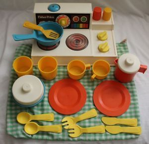 I used to love this thing!!!! Oh man the things I wish I would have kept! Vintage Fisher Price Magic Burner Stove.